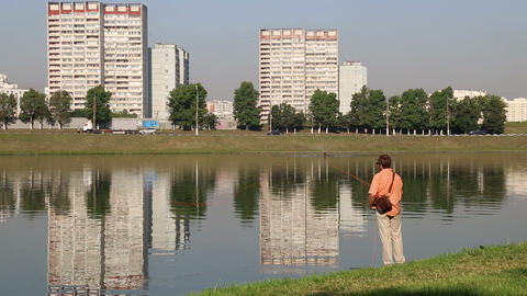 Fisherman On The Fly On The City Pond stock footage