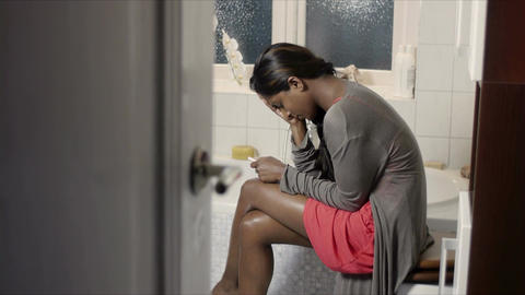 Worried Young Woman With Pregnancy Test Kit stock footage
