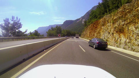 Car overtaking the truck. Driving with a camera on Footage