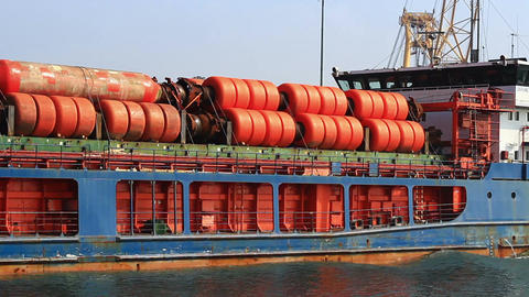 Cargo ship with loaded gas pipes Footage