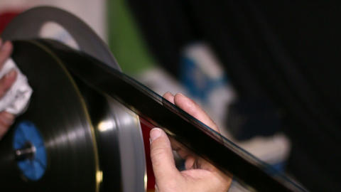 Film Technician Rewinding And Checking 35mm Film stock footage