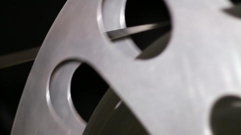 35mm Film Cinema Reel Rewinding stock footage