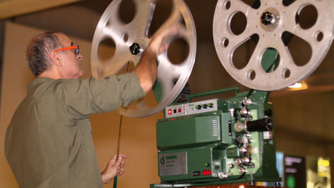 Film Technician Mounting 16mm Film stock footage