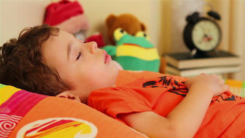 Two years old boy sleeping Live Action