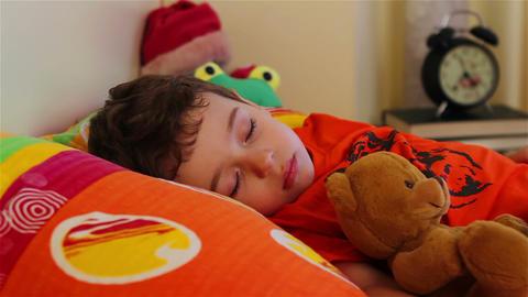 Cute little boy sleeping with his teddy bear 1 Footage