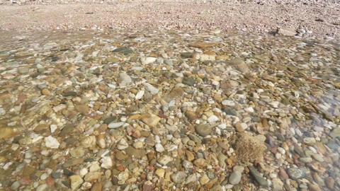 Pebbles on the sunny beach Footage
