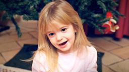 Christmas Eve little girl happy hooray Footage