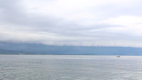 storm clouds hovering over the island view from th Footage