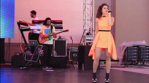Singer in the orange dress GIF