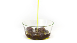 Adding olive oil to black olives Footage