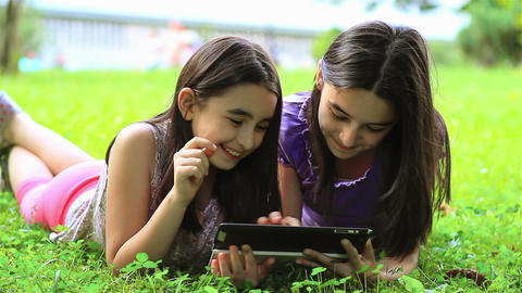 Girls Playing On Digital Tablet Outdoors stock footage