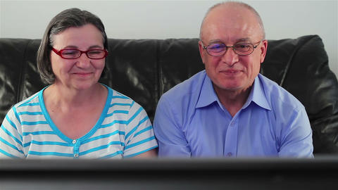 Happy Senior Couple Watching Television Together stock footage