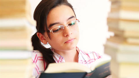 Teenage Girl Studying With Textbooks 2 Footage