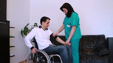 Blood Pressure Check For Young Adult In Wheelchair stock footage