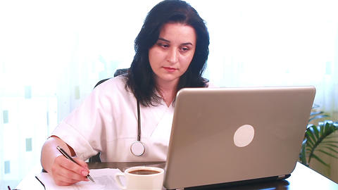 Doctor working on her laptop computer Footage