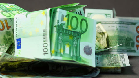 Falling Euro And Dollars stock footage