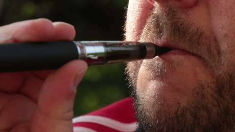 Smoking Electronic Cigarette stock footage