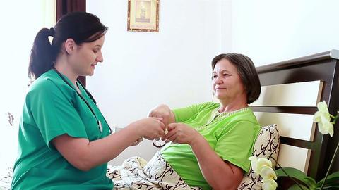 Senior Woman Taking Medicine From Nurse stock footage