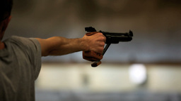 Hand with gun Stock Video Footage