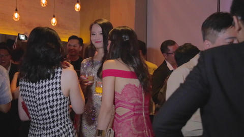 Glamour Asian girls enjoying drinks in lounge - do Live Action