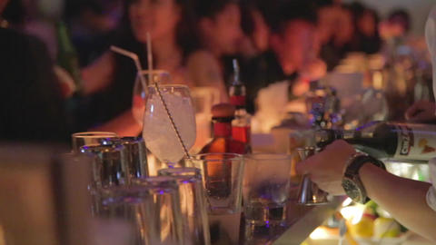 cinematic dolly shot of bartender mixing a drink Footage