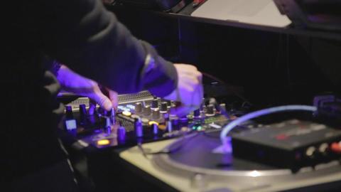 Close - DJ adjusting controls - cinematic Footage
