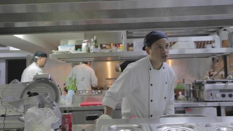 dolly shot - restaurant kitchen - Asian cooks 2 Footage