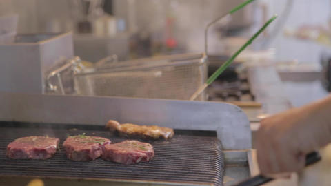 dolly shot - uncooked steak on the grill Footage