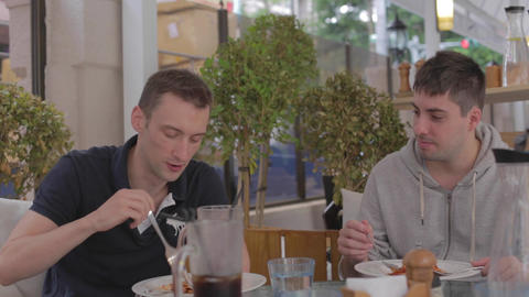 2 Caucasion Men Enjoying Casual Italian Lunch stock footage