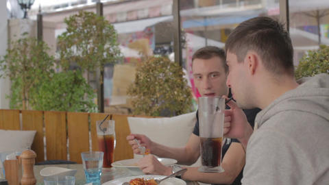 Friends enjoying a coke and pasta Live Action