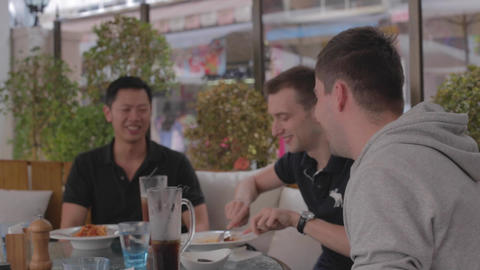 International friends enjoying casual lunch Live Action