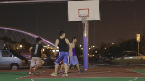 Asian men play basketball at the key Footage
