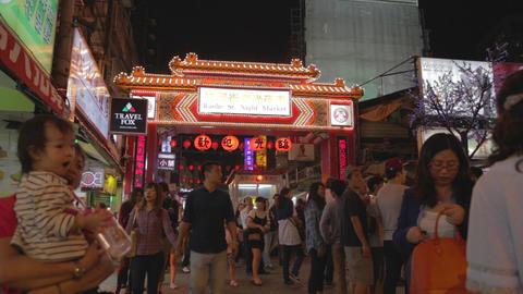 entrance of Raohe night market - wide christmas li Live Action