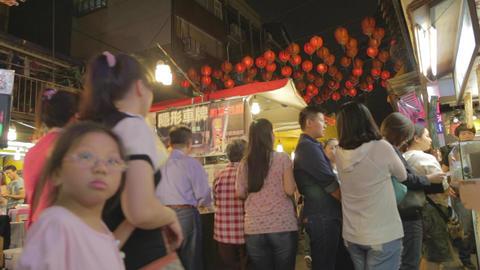 people walking lanterns - Raohe night market Live Action