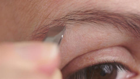 Woman Plucking Eyebrows Macro Footage