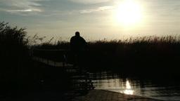 4K Mature Man Walking On Pier In Autumn Sunset 2 stock footage