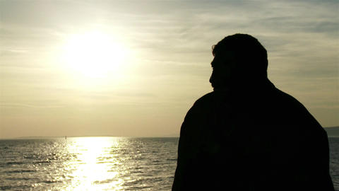 4K Mature Man in the Sunset Silhouette at Lake 1 Footage