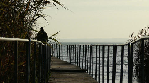 Mature Man Walking on Pier in Autumn Sunset Footage
