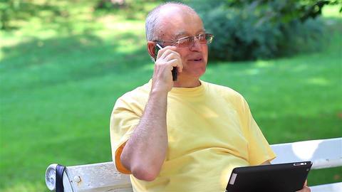 Senior man talking on smartphone Live Action