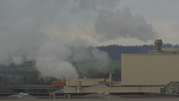 Chemical factory with smoke stack, air pollution Footage