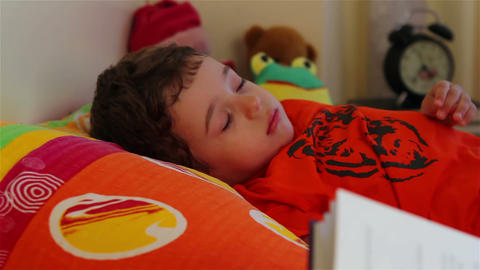Reading story for little boy to sleep 1 Footage