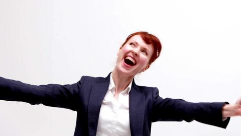 Businesswoman cheering on white background Footage