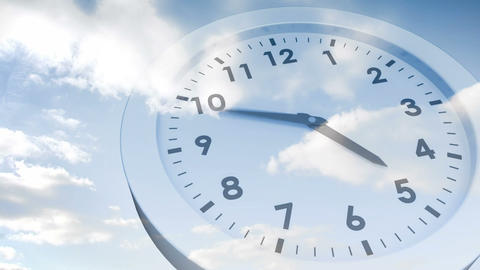 Clock ticking against blue sky Animation