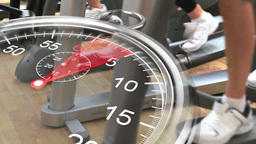 Stopwatch graphic over cross trainers at gym Animation