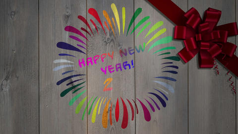 Happy New Year Message Against Wood With Bow stock footage