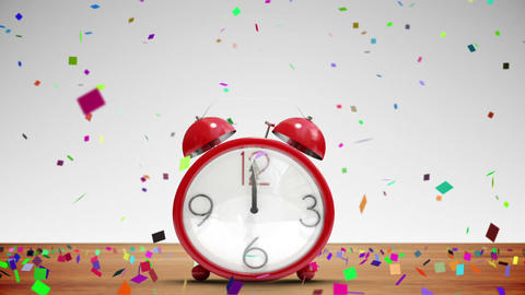 Cute alarm clock counting to midnight with confetti Stock Video Footage