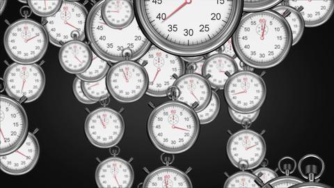Stopwatches falling on black background Animation