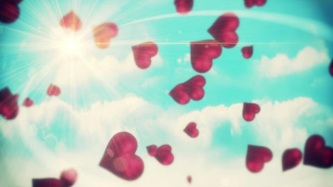 Pink hearts floating against blue sky Animation