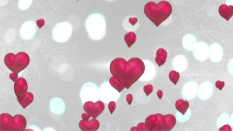 Pink Hearts Floating Against Glittering Background stock footage