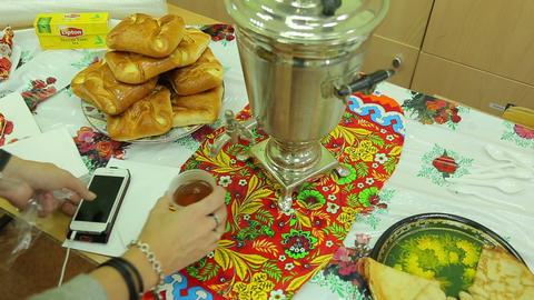 Charity fair, pours tea from a samovar Footage